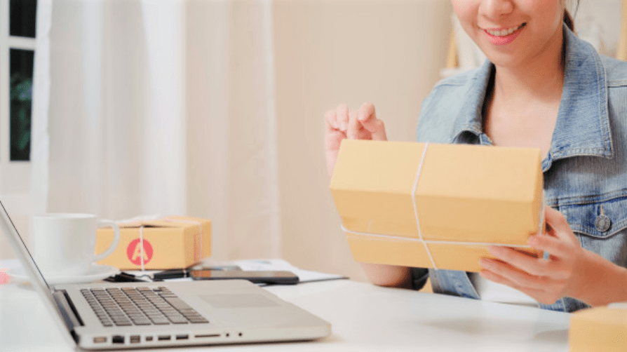 Online store owner processing an order and packaging.